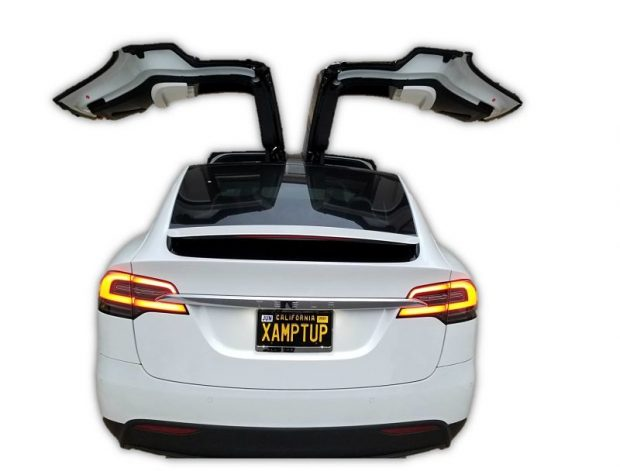 photo of tesla model x with both falcon doors wide open