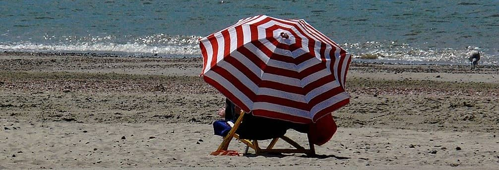 photo of person obscured by umbrella
